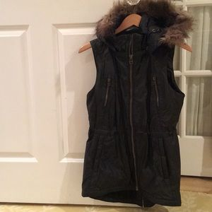Black vest with faux fur around hood